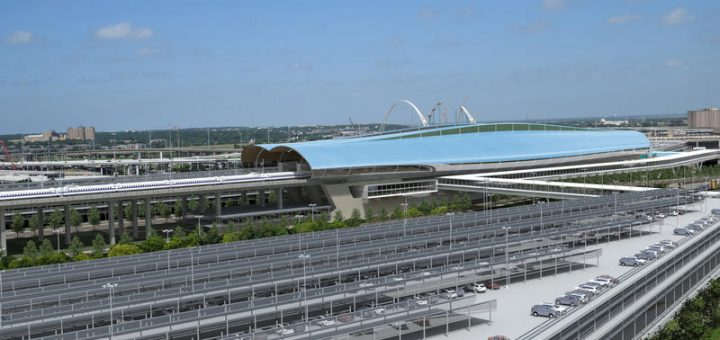 从三一河流域望向西南的子弹火车站东北的停车场结构的视图。